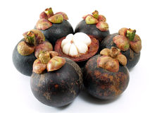 Close up pile of mangosteens and peeled half isolated on white background Royalty Free Stock Photo