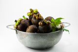 Mangosteen is the queen of tropical fruit Stock Photos