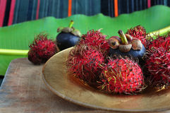 Mangosteen and rambutan on golden plate Stock Photography