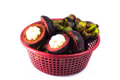 Mangosteen in red basket  isolated Royalty Free Stock Photography