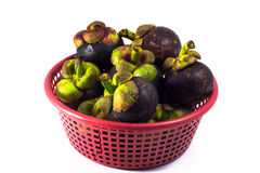 Mangosteen in red basket  isolated Stock Photo