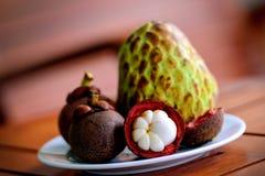 Mangosteen and Thai sugar Apple Naina. On a plate Stock Image