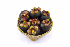 Mangosteen in wicker basket isolated on white background. Stock Photography