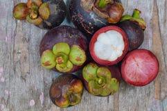 Mangosteen on wood table Stock Photo