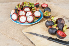 Mangosteen on wood table. Royalty Free Stock Photography