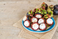 Mangosteen on wood table. Royalty Free Stock Images