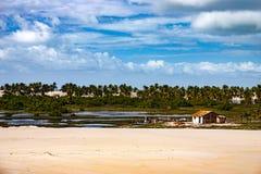 Mangue Seco, Bahia, northeast Brazil. Simple house close to sand dunes en beach, palm trees, Mangue Seco village, Jandaira, Bahia state, Brazil, circa 2005 stock photography