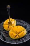 Mangue servie d'une glace Photos stock