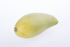 mangues ou mangues jaunes de vert sur le fond Image libre de droits