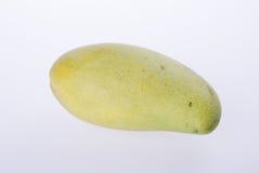mangues ou mangues jaunes de vert sur le fond Photos libres de droits