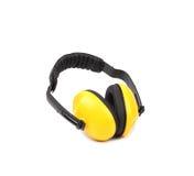 Manguitos protectores amarillos del oído Imagenes de archivo