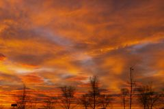 Manhã com nuvens vermelhas Imagem de Stock