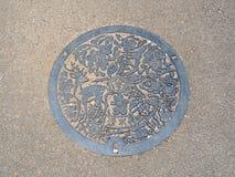 Manhålavrinningräkning på gatan på Nara, Japan royaltyfria bilder