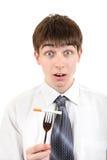 Manhållcigarett på gaffeln Arkivfoto