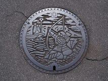 Manhålräkning i Takamatsu, Kagawa, Japan arkivbild