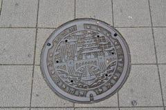 Manhålräkning, Osaka, Japan fotografering för bildbyråer