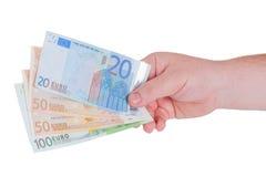Manhand med pengar Arkivbilder