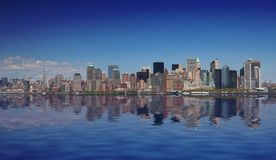 Manhattan. Aerial panoramic with water reflection Stock Photos