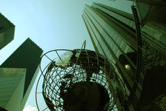 Manhattan. This is a shot of a stainless steel globe. The shot was taken from a lower angle looking up. This captured the buildings rising above it Royalty Free Stock Images