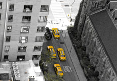 Manhattan from above. Black and white background with view of yellow taxi cabs from roof of a building in Manhattan, New York Royalty Free Stock Photos