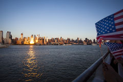 Manhattan and America flag  seen from the Hudson River on Independence Day Royalty Free Stock Photo