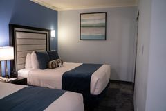 Typical two bed hotel room with queen size beds and modern decor at a Best Western stock photography