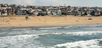 Manhattan Beach Panorama. Panoramic view of Manhattan Beach in California showing surf, houses and skyline Royalty Free Stock Photography