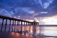 Manhattan Beach Pier. Low tide reflections of the Manhattan Beach Pier, Los Angeles County, California royalty free stock photo