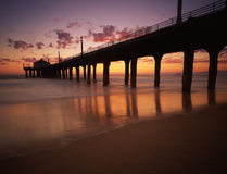 Manhattan Beach Pier. The Manhattan Beach pier juts out into the Pacific ocean on a typical Los Angeles summer evening.  Sunset from Santa Monica to Palos verdes Stock Images