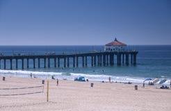 Manhattan beach Pier california summer. People walking on the manhattan beach pier in Manhattan Beach California on the pacific ocean Stock Photo