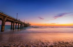 Manhattan Beach Pier at Dusk. The Manhattan Beach Pier under a beautiful sunset and the best summer evening at pacific beach Los Angles Royalty Free Stock Images