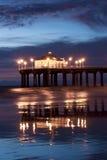 Manhattan Beach Pier After Nightfall. Low tide reflections of the Manhattan Beach Pier, Los Angeles County, California stock photo