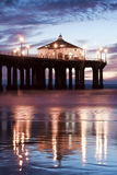 Manhattan Beach Pier After Nightfall 50mm. Low tide reflections of the Manhattan Beach Pier, Los Angeles County, California stock image