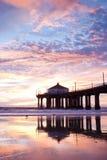 Manhattan Beach Pier Nightfall Reflections. Low tide reflections of the Manhattan Beach Pier, Los Angeles County, California royalty free stock photo