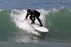 Manhattan Beach Surfing. MANHATTAN BEACH, CALIFORNIA, USA - SEPTEMBER 28, 2012. Surfers enjoy large waves on September 28, 2012.  Large waves are caused by the Royalty Free Stock Photo