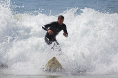 Manhattan Beach Surfing. MANHATTAN BEACH, CALIFORNIA, USA - SEPTEMBER 28, 2012. Surfers enjoy large waves on September 28, 2012.  Large waves are caused by the Stock Photo