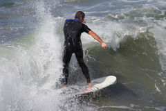 Manhattan Beach Surfing. MANHATTAN BEACH, CALIFORNIA, USA - SEPTEMBER 28, 2012. Surfers enjoy large waves on September 28, 2012.  Large waves are caused by the Stock Image