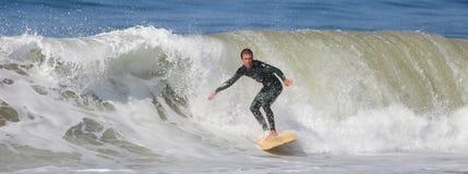 Manhattan Beach Surfing. EL PORTO, MANHATTAN BEACH, CALIFORNIA, USA - OCTOBER 1. Surfers enjoy large waves on October 1, 2012. El Porto is a popular beach with Stock Photo