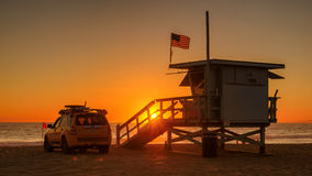 MANHATTAN BEACH, USA - MARCH 27, 2015: Lifeguard tower at orange sunset on March 27, 2015 in Manhattan Beach Stock Photography