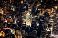 Manhattan bis zum Nacht Stockbilder