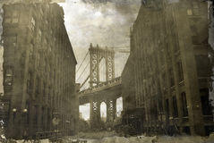 Manhattan Bridge. The Manhattan Bridge from Washington street in Brooklyn. Photography on a grunge vintage background and simulate damaged borders Royalty Free Stock Images