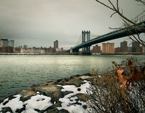 Manhattan Bridge. A view of Manhattan Bridge from the snowy shores of DUMBO, in Brooklyn Royalty Free Stock Photos