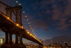 Manhattan Bridge at blue hour. Freedom Tower peeking under Manhattan bridge arch at night Royalty Free Stock Photo