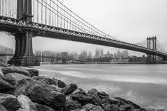 Manhattan Bridge and Downtown Manhattan view on foggy day Royalty Free Stock Photo