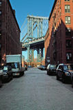 Manhattan Bridge DUMBO New York USA. Empire State Building seen here in afternoon Washington Street view of the Manhattan Bridge in the DUMBO district of stock photo