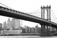 The Manhattan Bridge and East River, seen from DUMBO, in Brooklyn, New York City.  stock photo