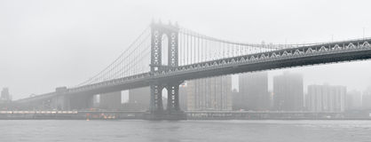 Manhattan Bridge in a fog. Stock Photos
