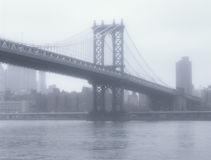 Manhattan Bridge at fog. Manhattan Bridge at foggy day - soft focus image Royalty Free Stock Images