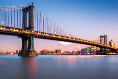 Manhattan Bridge illuminated at dusk Royalty Free Stock Images