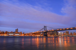 Manhattan Bridge and Lower Manhattan at night Stock Photos